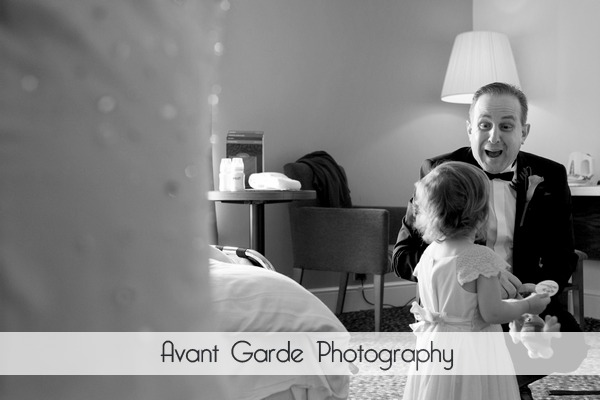 father of the bride smiling at grand daughter in hotel room in Alnwick before the wedding
