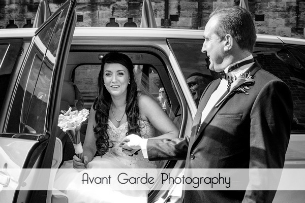 Brides father helping bride out of car at Alnwick Castle wedding