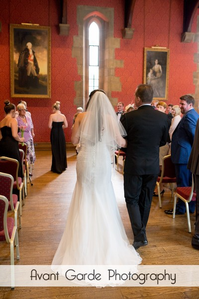 bride and dad walking down aisle at alnwick castle