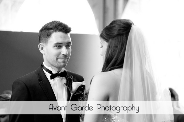 groom looking at bride during Alnwick Castle wedding ceremony
