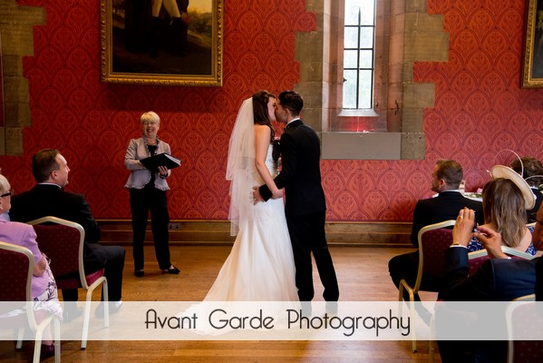 bride and groom kissing during wedding ceremony at Alnwick castle