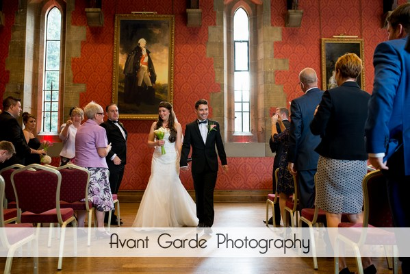 bride and groom walking down the aisle at Alnwick castle wedding