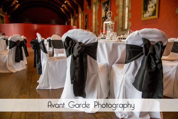 wedding chairs with black sash