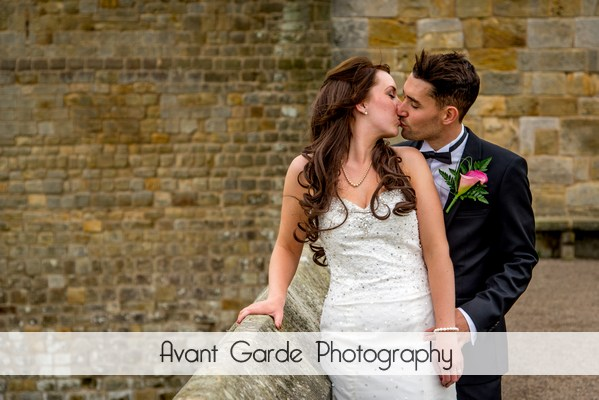 wedding photo of bride and groom kissing in castle