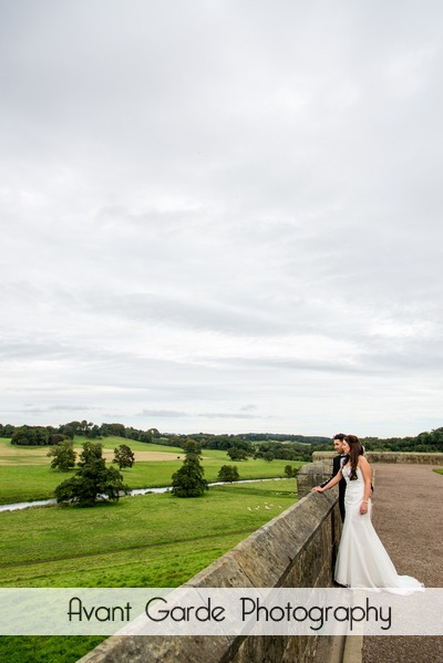 bride and groom in alnwick castle looking at northumberland countryside
