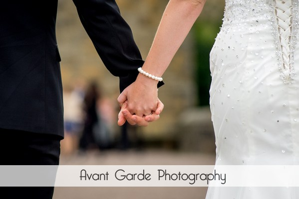 close up wedding photograph of bride and grooms hands