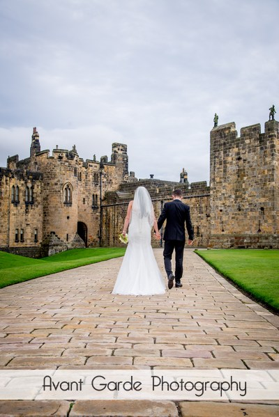 newly weds walking in alnwick castle