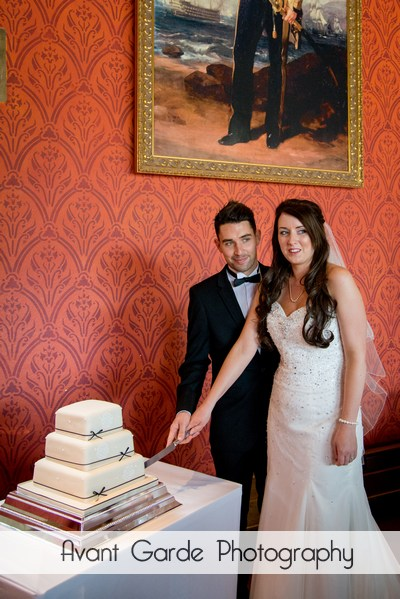 cutiing the cake at alnwick castle wedding