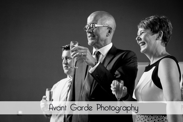 wedding guest toasting bride and groom