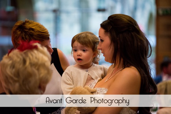 bride and daughter talking to guests at evening reception