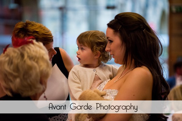 bride and flower girl talking to guests at evening reception